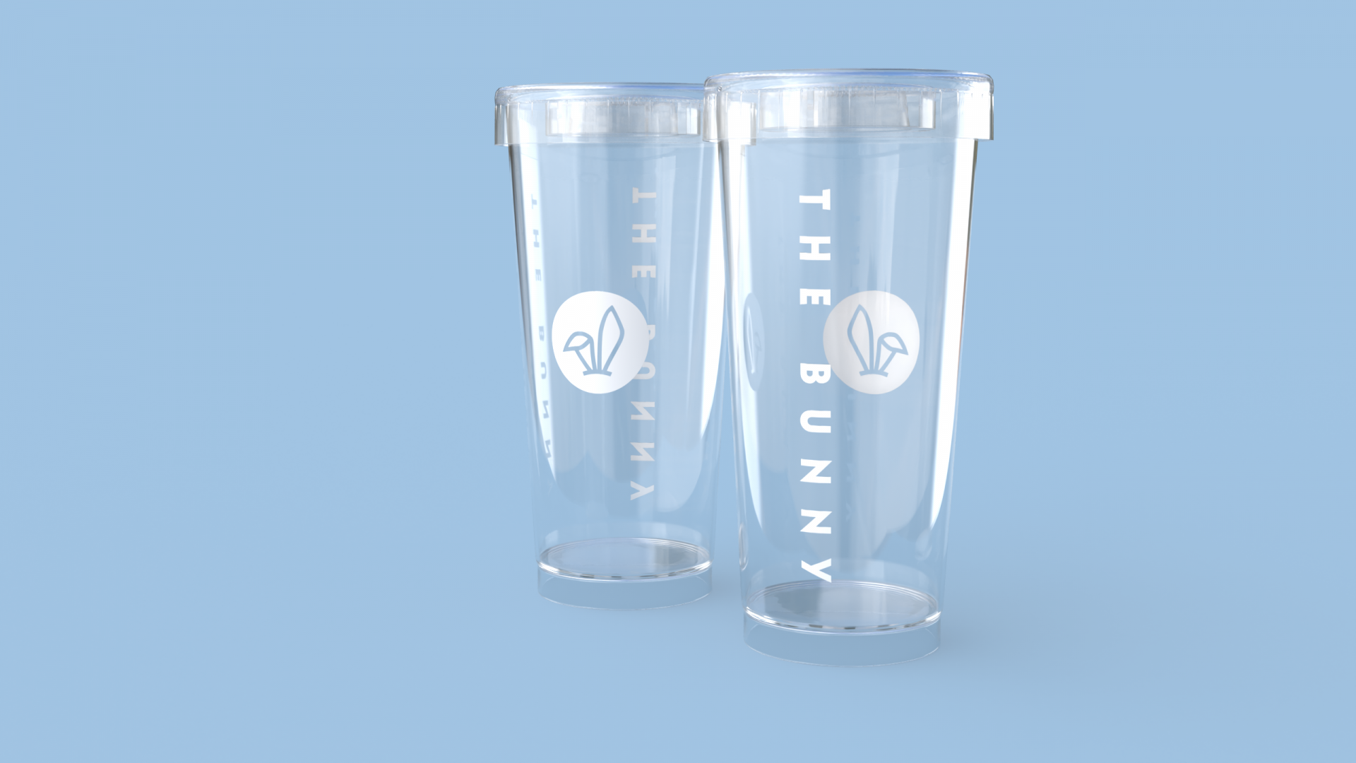 Brand identity design by Crate47. The Bunny bubble tea logo in white on clear plastic glasses against blue background.