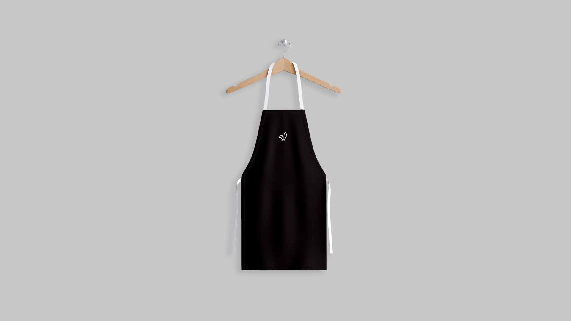Brand identity design by Crate47. The Bunny bubble tea logo marque in white on a black apron.