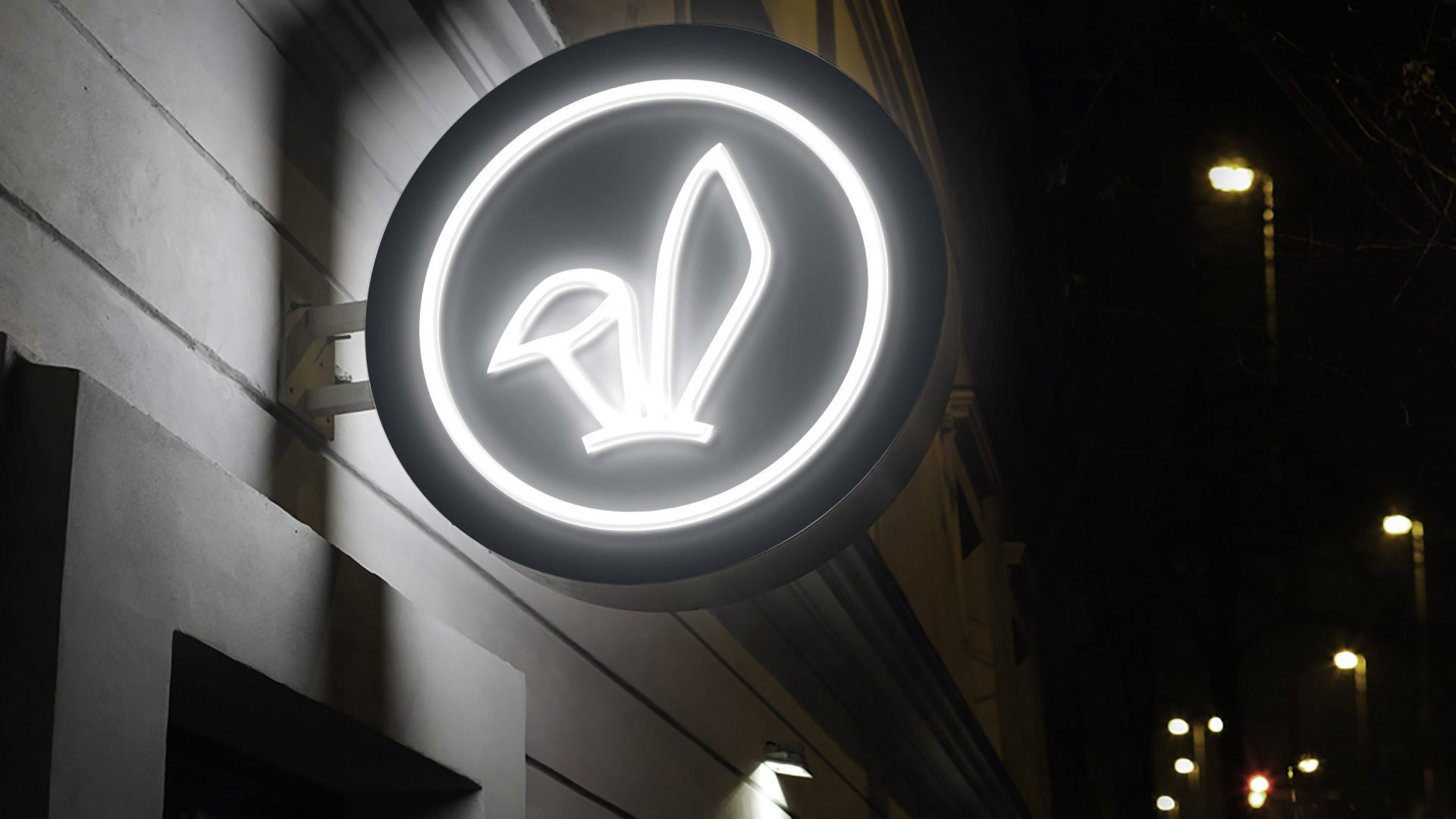 Brand identity design by Crate47. The Bunny bubble tea logo marque used on a circular white neon sign.