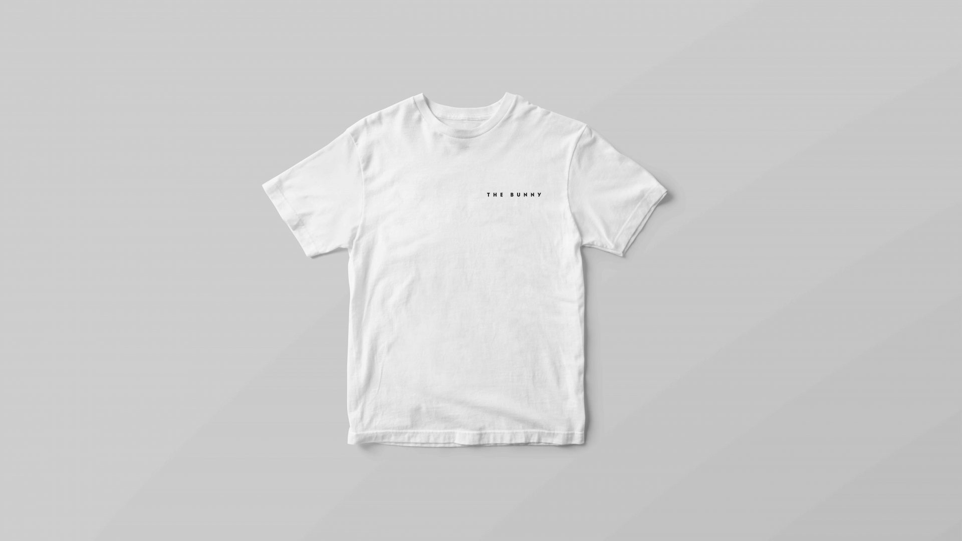 Brand identity design by Crate47. The Bunny bubble tea logo in black on a white T-shirt.