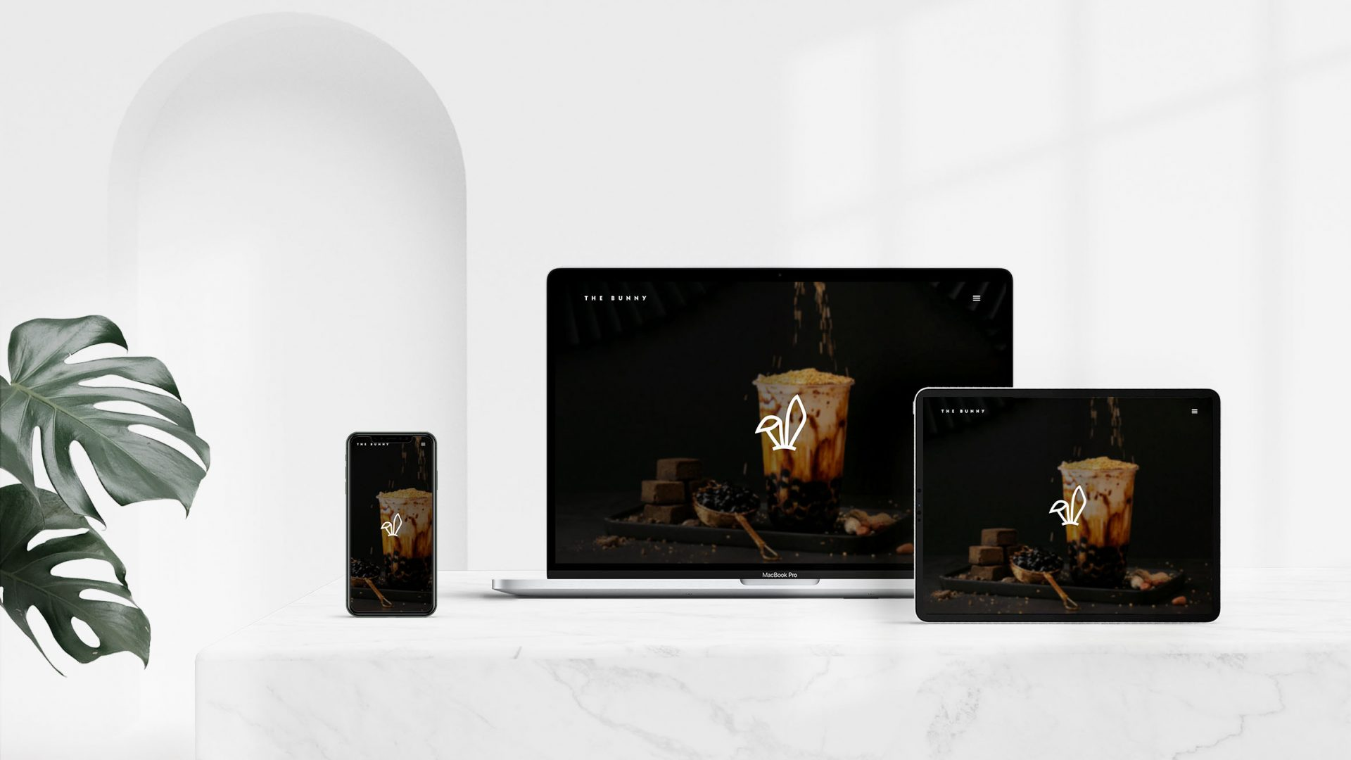 Brand identity design by Crate47. The Bunny bubble tea logo and marque as used on a website design. Shown on 3 devices.