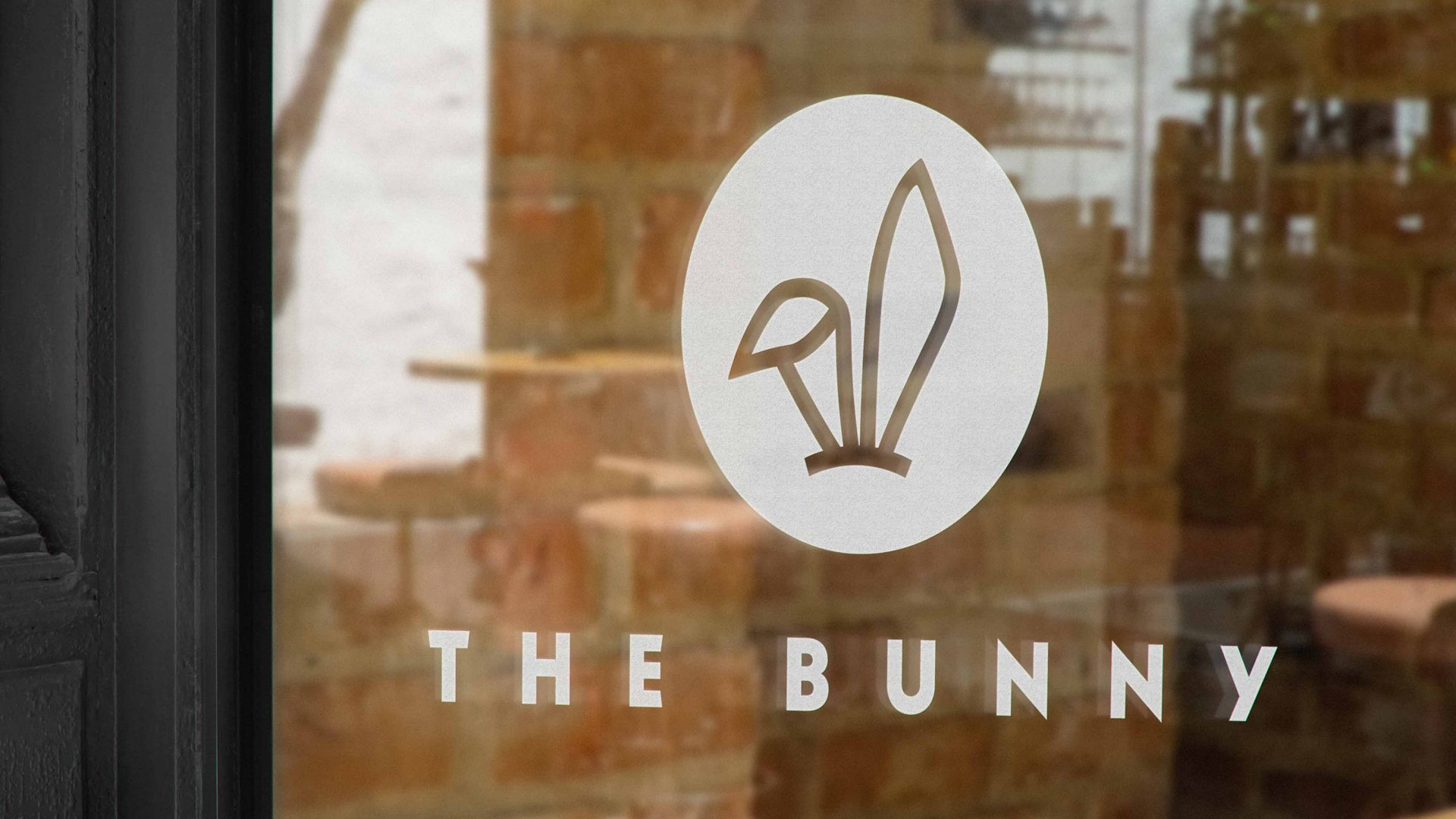 Brand identity design by Crate47. The Bunny bubble tea logo and marque in white on a shop window